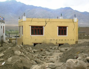 Modern building outside Leh town cracked under pressure of the flash floods