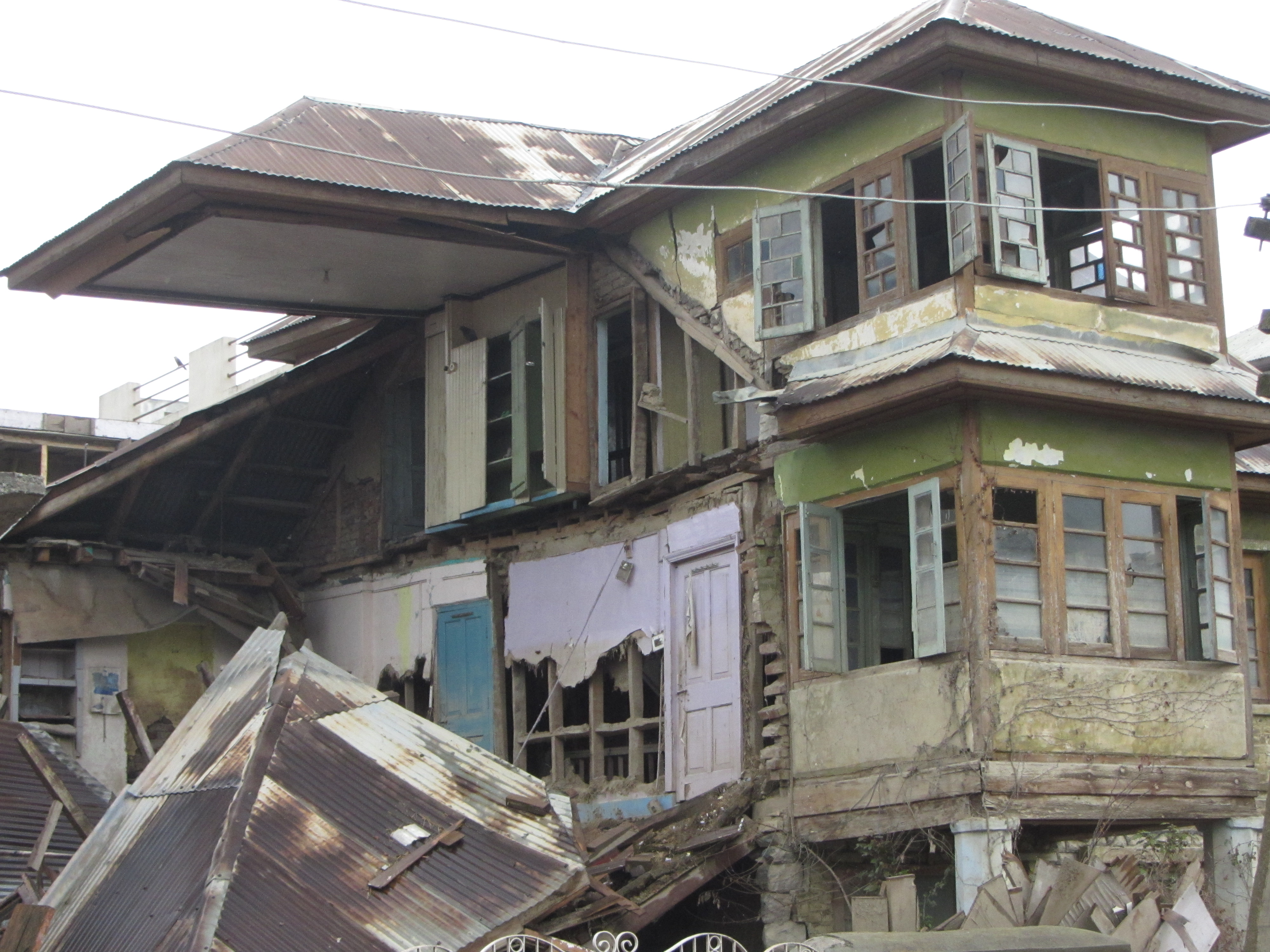 A devastated house  in Srinagar stands in dilapidated condition six months after it remained underwater for over a month in September 2014 Kashmir floods.
